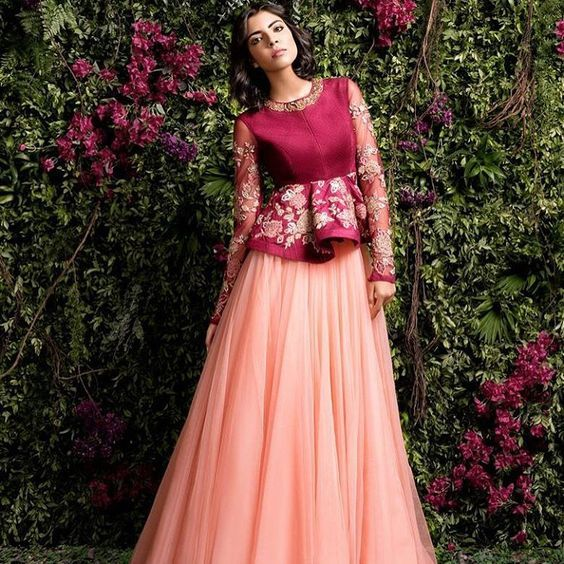 The ultimate guide for the Indian Bride to plan her dream wedding. Witty Vows shares things no one tells brides, covers real weddings, ideas, inspirations, design trends and the right vendors, candid photographers etc| This peach and magenta #shyamalBhumika stunning Gown with a peplum top <3 <3 <3  #bridal#IndianWedding #bridal #fashion #peplum | Curated by #WittyVows - The ultimate guide for the Indian Bride | www.wittyvows.com