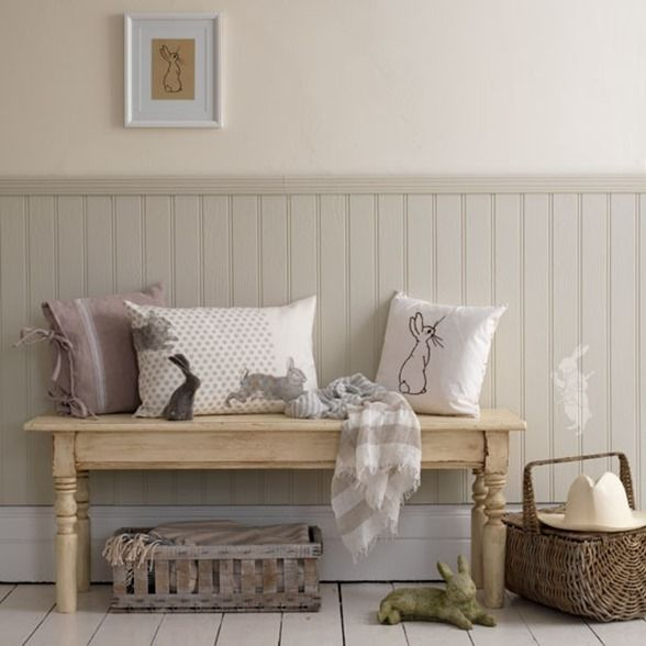 tongue and groove wall paneling; muted painted wainscoting, high baseboard