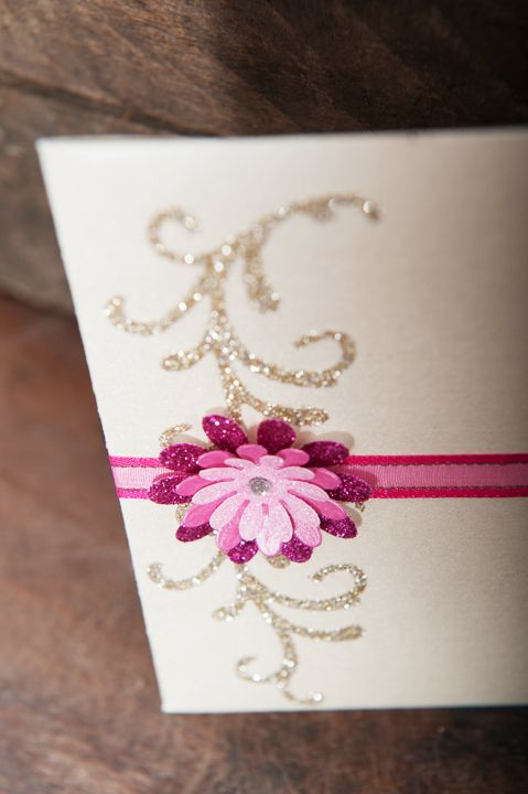 Dainty, pink and gold petal fold wedding invitation with shaded pink 3D flower and hot pink and gold organza ribbon to close