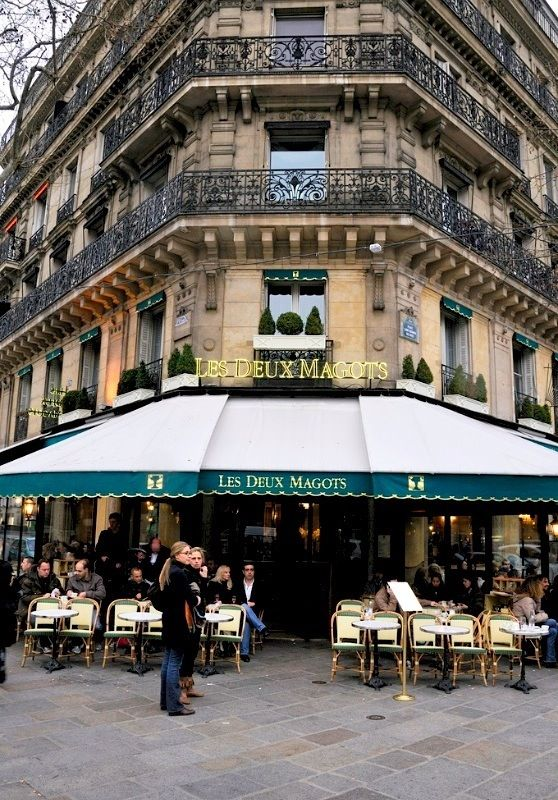 I always dream of sitting at a cafe in Paris.  One of my favorite things to do.
