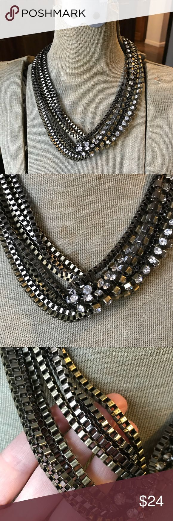 Calvin Klein Brass & Rhinestone Necklace Calvin Klein Brass & Rhinestone Necklace. Cool, edgy and sophisticated all at once! Worn a couple of times and then stored in jewelry box. Great condition Calvin Klein Jewelry Necklaces