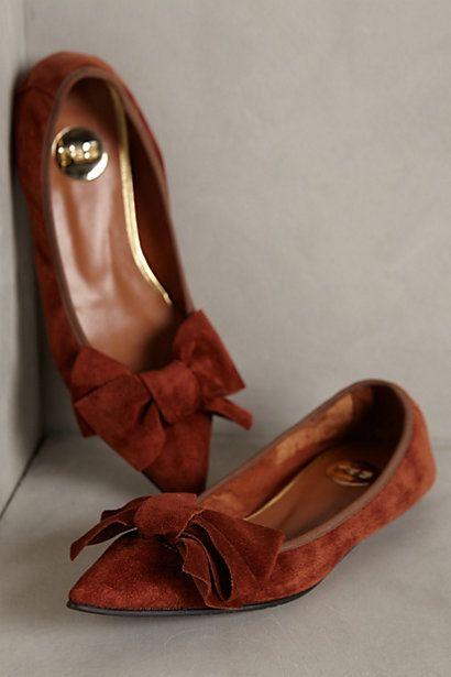 sleek orange suede bow tie flats #anthrofave http://rstyle.me/n/sxv3ar9te