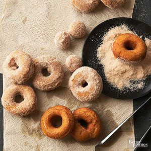 Spiced Pumpkin Doughnuts: These delicious homemade doughnuts are rolled in a mixture of sugar, nutmeg, and cinnamon, complementing their pumpkin flavor./