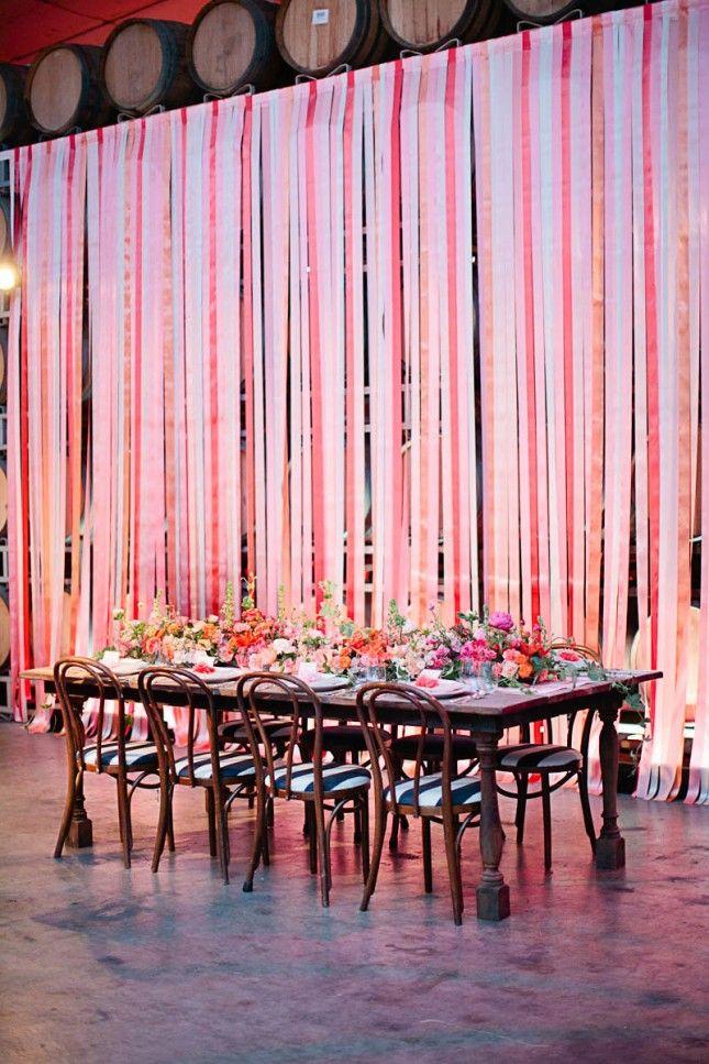 Hide boring walls with ribbon at your wedding venue.