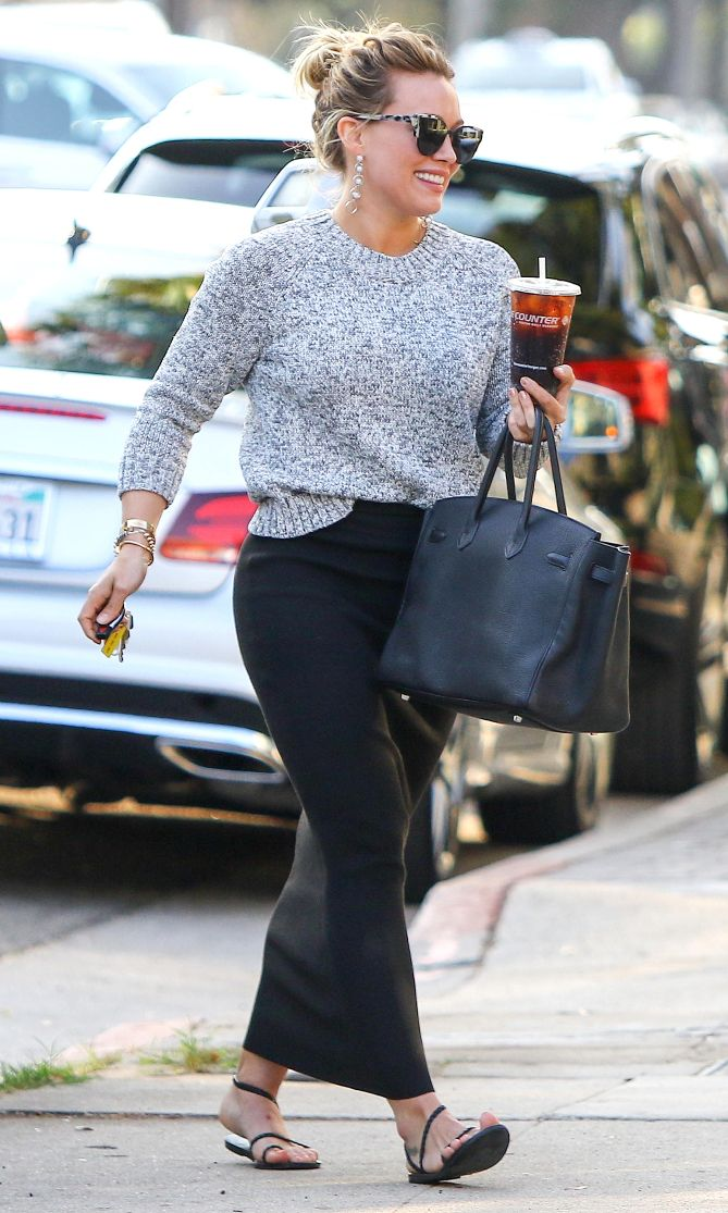 Hilary Duff in a grey sweater and maxi skirt - click ahead for more fall and Thanksgiving outfit ideas!