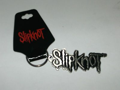 Metal die cut key-chain black enamel filled featuring the Slipknot logo. We offer OFFICIALLY LICENSED APPAREL, ART & ACCESSORIES from bands and artists all over the world. If you love the music and in