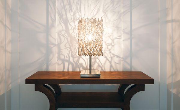 A Brand Van Egmond lamp on a custom-built table casts undulating shadows on the second-floor landing.