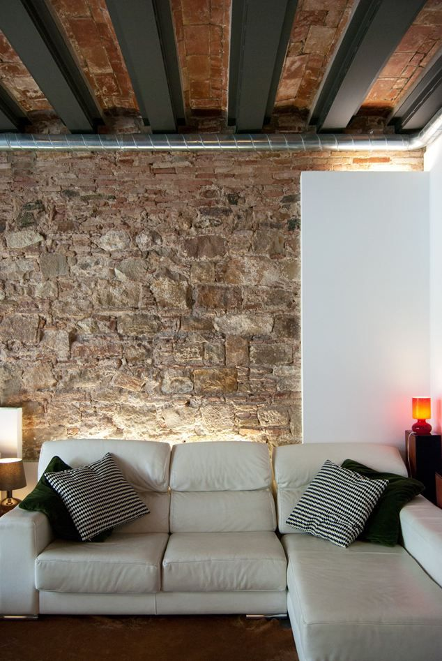 Another great way to highlight the stone wall by adding an LED stip light behind the sofa. Refurbishment Of A Patio-house In Gracia, Barcelona, Spain 2013. Photo by Carles Enrich.