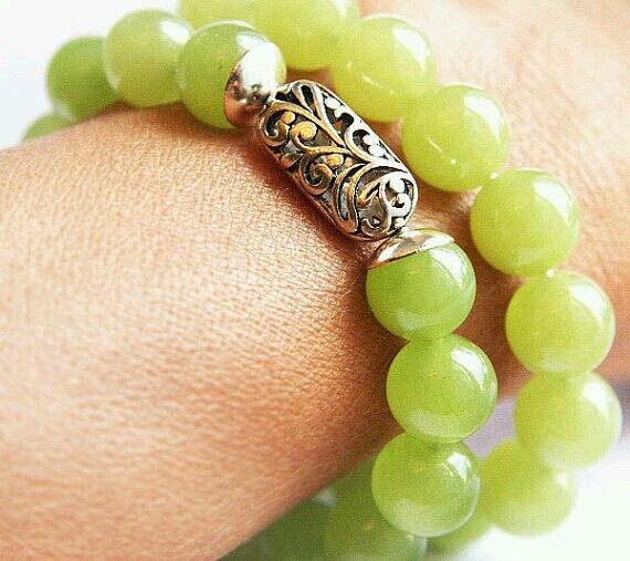 green bracelet with engraved silver closure