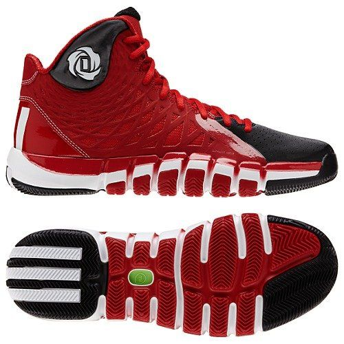 This Adidas basketball shoe is colored black, red and white.