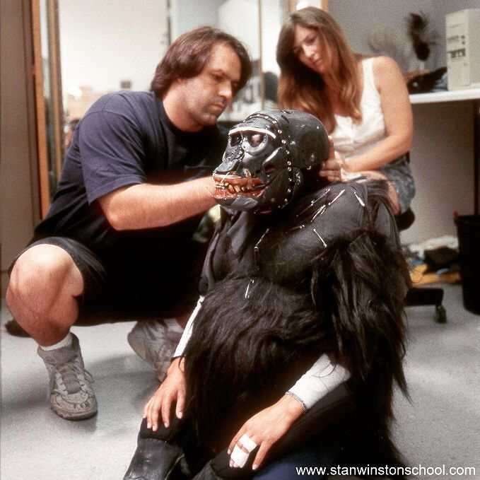 Fooling mother nature. In this #behindthescenes picture from #stanwinstonstudio mechanical designer Richard Haugen and costume fabricator Karen Mason during a test fitting with one of the mountain #gorillas created by the studio for the movie #instinct. #specialeffects #moviemagic #suitmaking