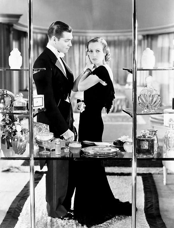 Joan Crawford and Clark Gable in Possessed directed by Clarence Brown , 1931