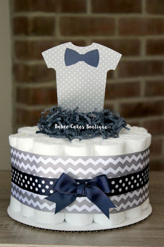 This listing is for ONE large single tier cake. Each cake comes with 20 size 1 Pamper Swaddlers diapers and sits on a 10 cake cardboard. These cakes are decorated on both sides, perfect for table centerpieces! For shipping purposes, the cake is wrapped in tulle and the topper is shipped on the side and will need to be inserted upon delivery. **If you would like to order more than one cake, please send me your shower date and zip code - and I can set you up a custom listing with combined…