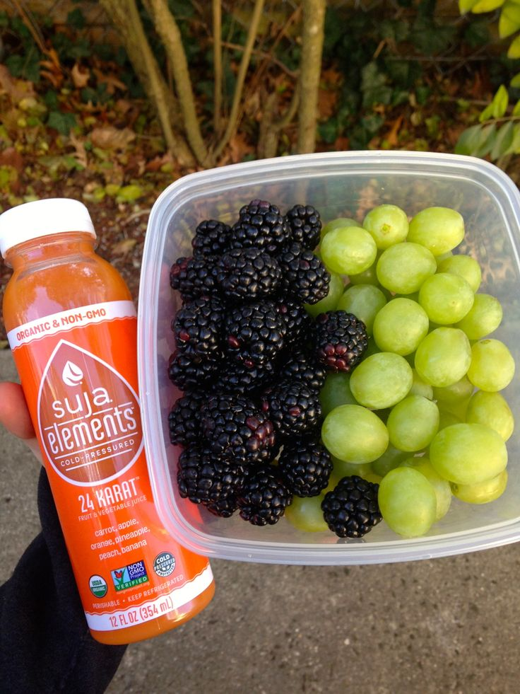"earth–eater: ""carrot, apple, orange, pineapple, peach, banana juice + blackberries & green grapes """