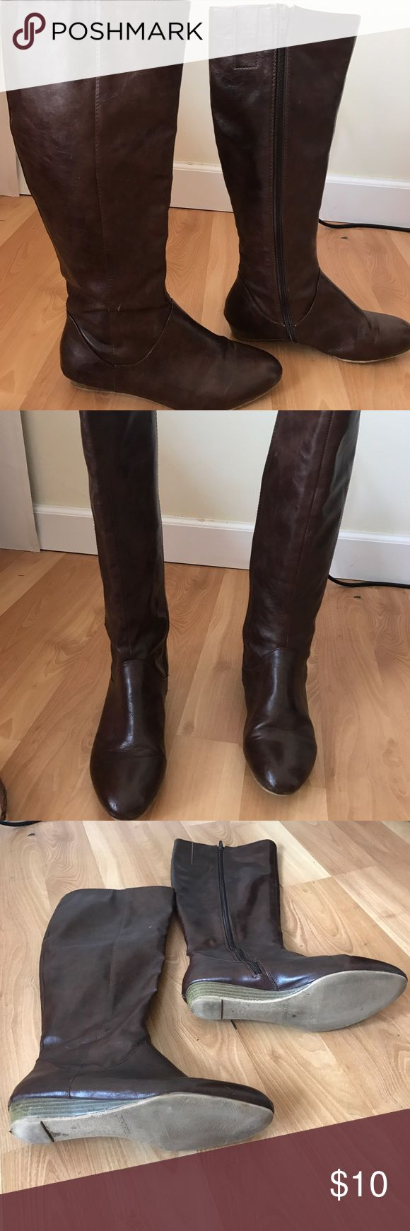 Knee high brown boots Good used condition boots from Old Navy. Size 9. Man made upper. Some wear at the toe and heel. thank you for visiting my closet!! Check out the rest of my closet for amazing 3+ 30% bundle discounts! I ship the next day. Thank you for shopping! Old Navy Shoes Winter & Rain Boots