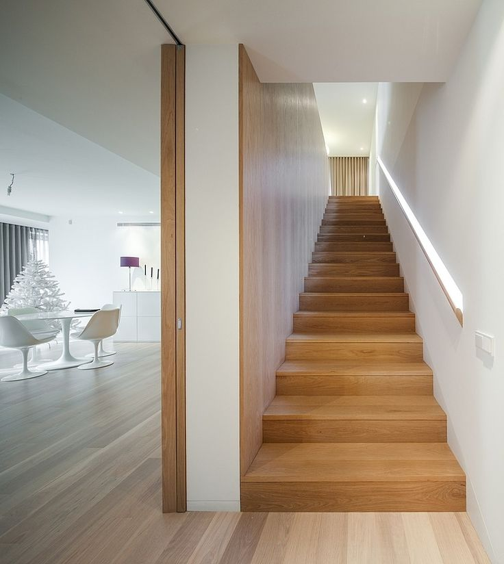 Wooden staircase with wooden wall. House in Penafiel by Graciana Oliveira.
