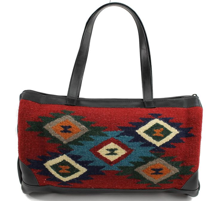 Onyx Arrow Western Zapotec Wool and Leather Barrel Purse, Black and Red Diamond Dust. Handwoven 100% Wool Zapotec Weaving. Southwestern style with vibrant coloring, handcrafted with sturdy construction exterior. Rich soft faux bomber leather with coil nylon zipper closure. Onyx Arrow Product care instruction card included. Measures approximately 18 inches long x 10 inches deep x 8 inches wide with a 10 inch shoulder drop.