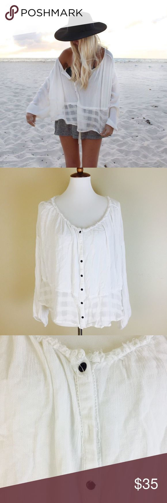 """Free People Rainy Days Gauze Top Boho Brand: Free People Details: Rayon loose gauze rainy days top. Perfect festival blouse. Ivory white Size: Large Measures approx 30"""" from underarm to underarm and 20-23"""" in length Gently pre-owned and ready to wear, missing a button though. Easy fix  Thanks for looking! Free People Tops Blouses"""