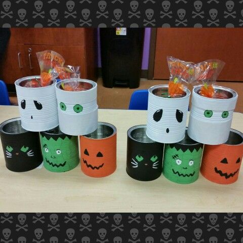 Made this for my daycare kids. Halloween treats and goodie bags. I used old formula cans or you can use tin cans for fun tin can crafts. Best to spray paint first with primer!