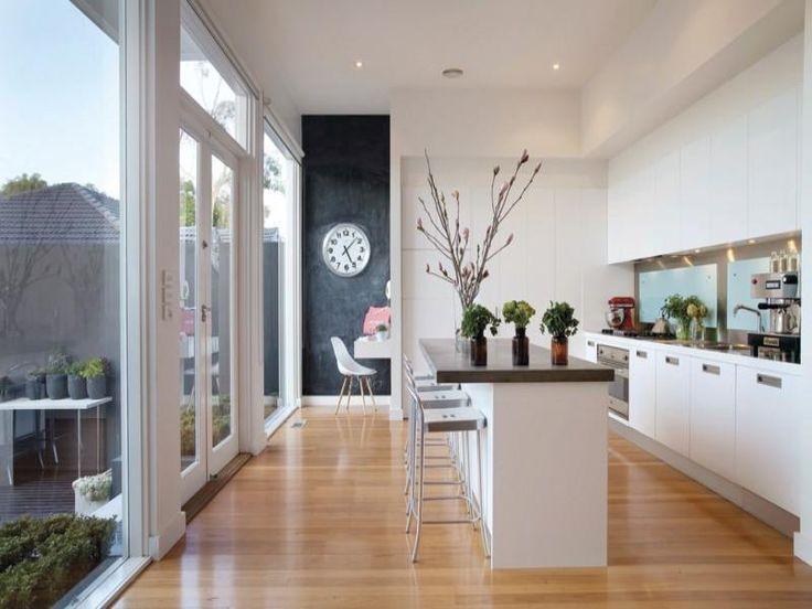 Glen Iris weatherboard home with lovely white kitchen on timber floors. #kitchen #timberfloors