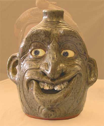 Pottery: Face Jugs, Snakes  Other by Melvin Crocker
