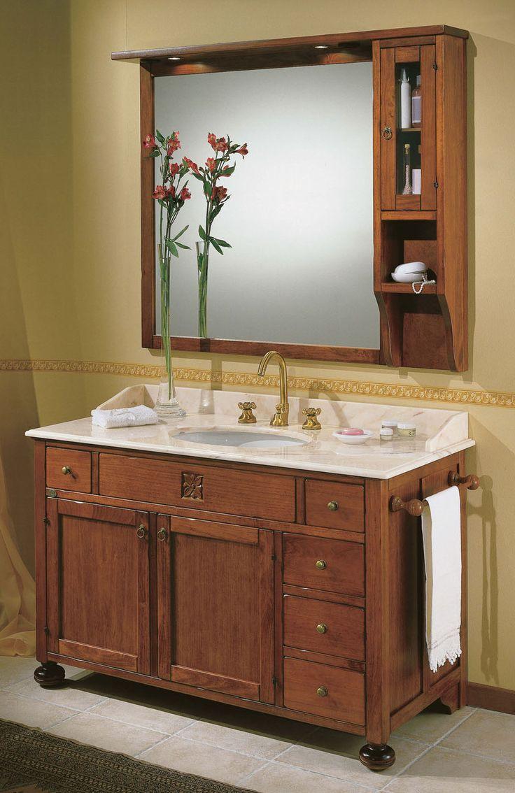 Maße:   130 x 61 x 200 cm Farbe:   Walnuss  Nussfarbener Waschtisch aus massivem Tulipierholz mit einem Top aus weißem Carrara-Marmor, einem großen Spiegel mit Spotlights zur Beleuchtung und mit Schränkchen, drei Schubladen und zwei Türen in der Basis.