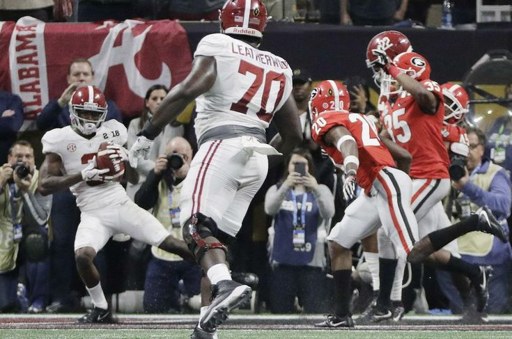 Tua Tagovailoa connected with DeVonta Smith for a 41-yard touchdown pass in overtime and Alabama defeated Georgia 26-23 in the College Football Playoff championship game on Monday night.
