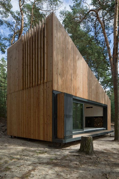 Wedge-shaped cabin provides a waterside retreat in a Czech forest.