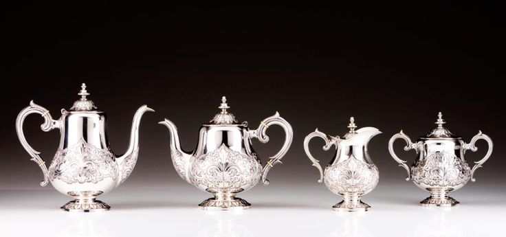 A Romantic coffee and tea set Portuguese silver of the 19th century  Comprising: a tea pot, a coffe pot, a milk jug with cover and a sugar bowl with cover  Round bases with relief friezes, pear-shaped… - Veritas Art Auctioneers - 21/02/2017
