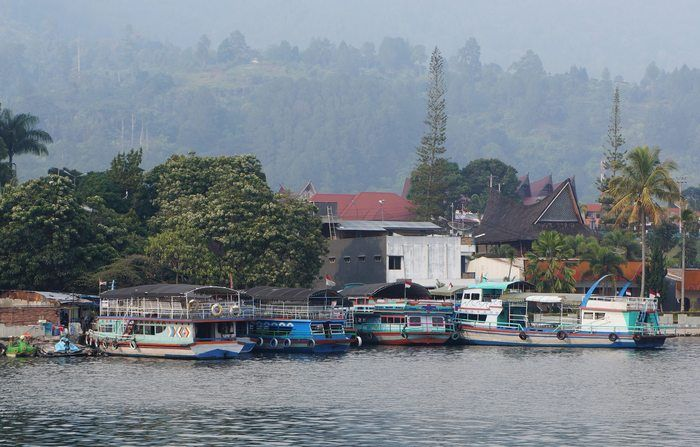 Set sail: Crossing Lake Toba to Samosir island by motor boat is done by either privately renting one or sharing with other visitors or locals. (Photo by Edna Tarigan)