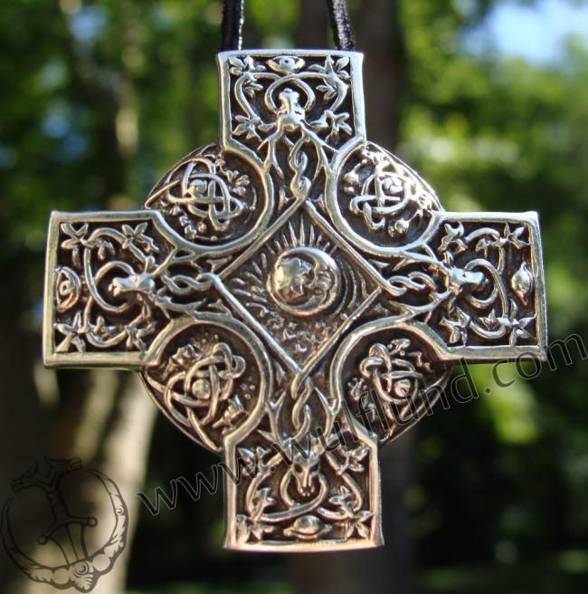 Proper Celtic Cross. The elongated bottom was added by Christians to more resemble theirs.