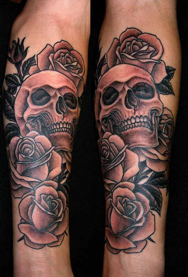 Skull and black rose tattoo on thigh for girls