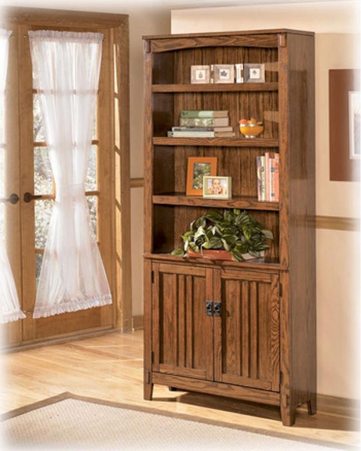 H31918 by Ashley Furniture in Winnipeg, MB - Large Door Bookcase