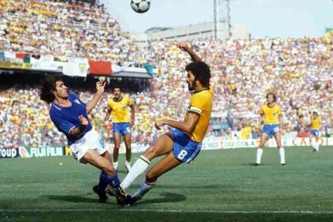 Italy 3 Brazil 2 in 1982 at Sarria Stadium, Barcelona. Socrates has a shot blocked in Round 2, Group C at the World Cup Finals.