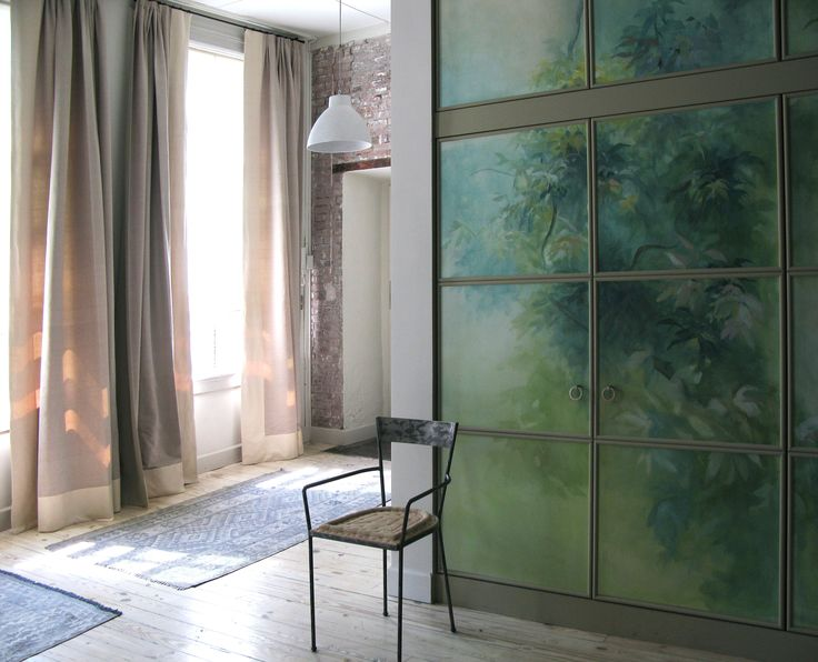 Picta handmade wallpaper. Vegetation painted on paper. The paper has been applied on the cabinet at a later time. Interior design by Barbara Frua.