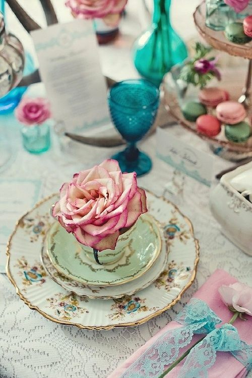 Mixing different tea sets and jewel colored tableware all come together in this fun and flirty gathering.