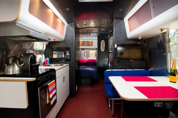 This sleek airstream cooking space would satisfy even the most discerning foodies — it's fully equipped with an oven, microwave, fridge and freezer.
