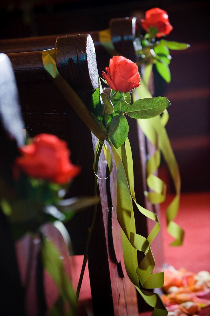 AK Brides - Wedding Planning Services  Single long stem roses tied with a ribbon as our pew markers for an old and historic church rich with history - Thank you Jerrod Brown Studios