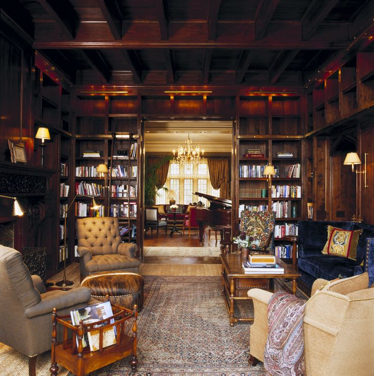 The library is composed with a mezzanine of structural walnut timbers.