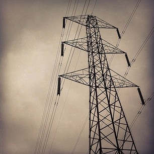 A storm brews over an electricity pylon. Another structure that divides opinion, I quite like them myself.