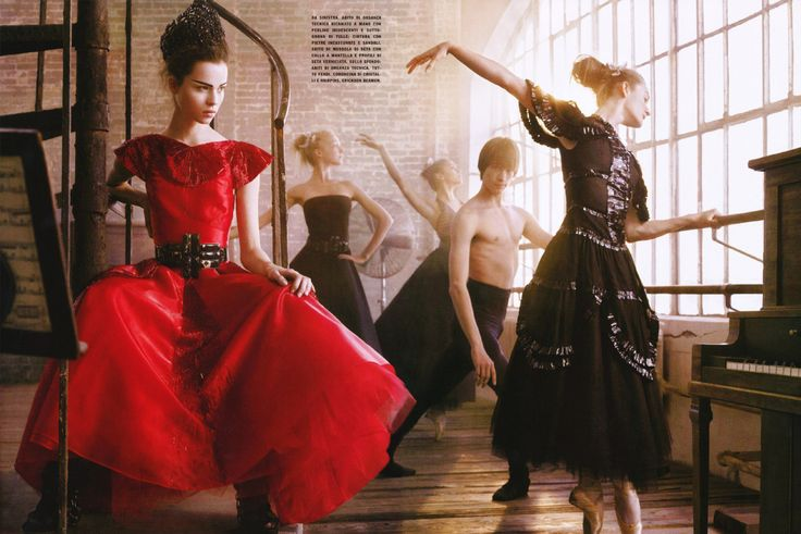 "Egle Tvirbutaite with dancers in ""In Time With The Music"" for Vogue Italia, March 2008. Photograph by Mark Seliger. ""Da sinistra, abito di organza, tecnica ricamato a mano con perline iridescenti e sotto-conna di tulle; cintura con pietre. Incastonate e sandali. Abito di mussola di seta con collo a mantella e profili di seta verniciata. Sullo sfondo. Abibi di organza tecnica tutto fendi. Coroncina di cristalle e mairpins, Erickson Beamon."""