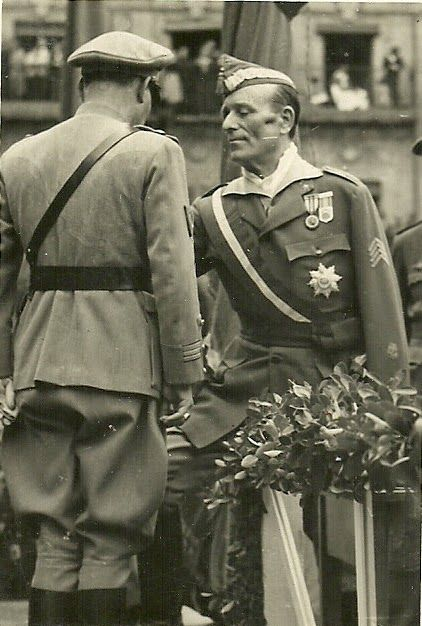 "Farewell to Franco's Portuguese ""Viriatos"" volunteers - Millan Astray gives medal to Portuguese officer - 4th june 1939 - Plaza Mayor, Salamanca, Spain - Spanish Civil War"