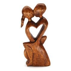 "CINTA EMBRACE WOOD CARVING Handcarved from sustainable rain tree wood, this sculpture sits 10"" high. Handmade by talented artisans in developing countries. Imported. Be sure to enter Kendra.IThoughtOfYou@gmail.com at checkout!"