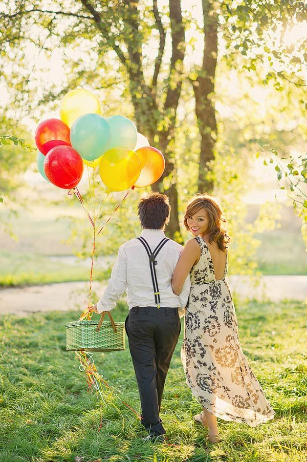 romantic Asian couple strolling with a bouquet of balloons.
