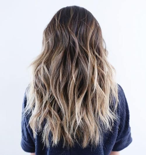 Long Choppy Hairstyle With Blonde Highlights