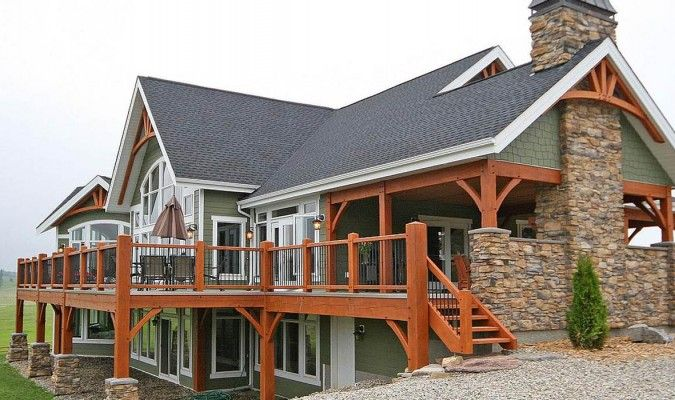 This design features picturesque windows, a wrap around deck, and modern open concept great room and dining area.