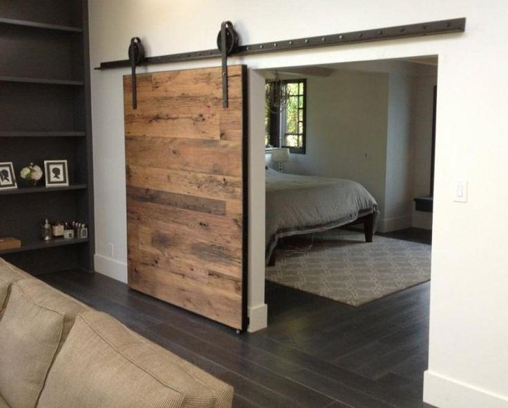 porte coulissante grange en bois avec rail et mécanismes en acier