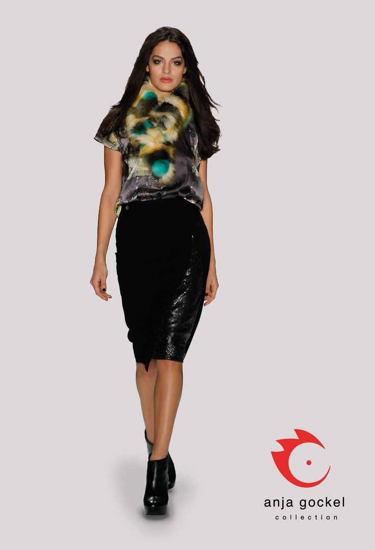 A luxurious outfit consisting of a fake leather sequin skirt in Italian length and a silken top in city print. A scarf of colorful fun fur adds a nice touch of sophistication to the ensemble.