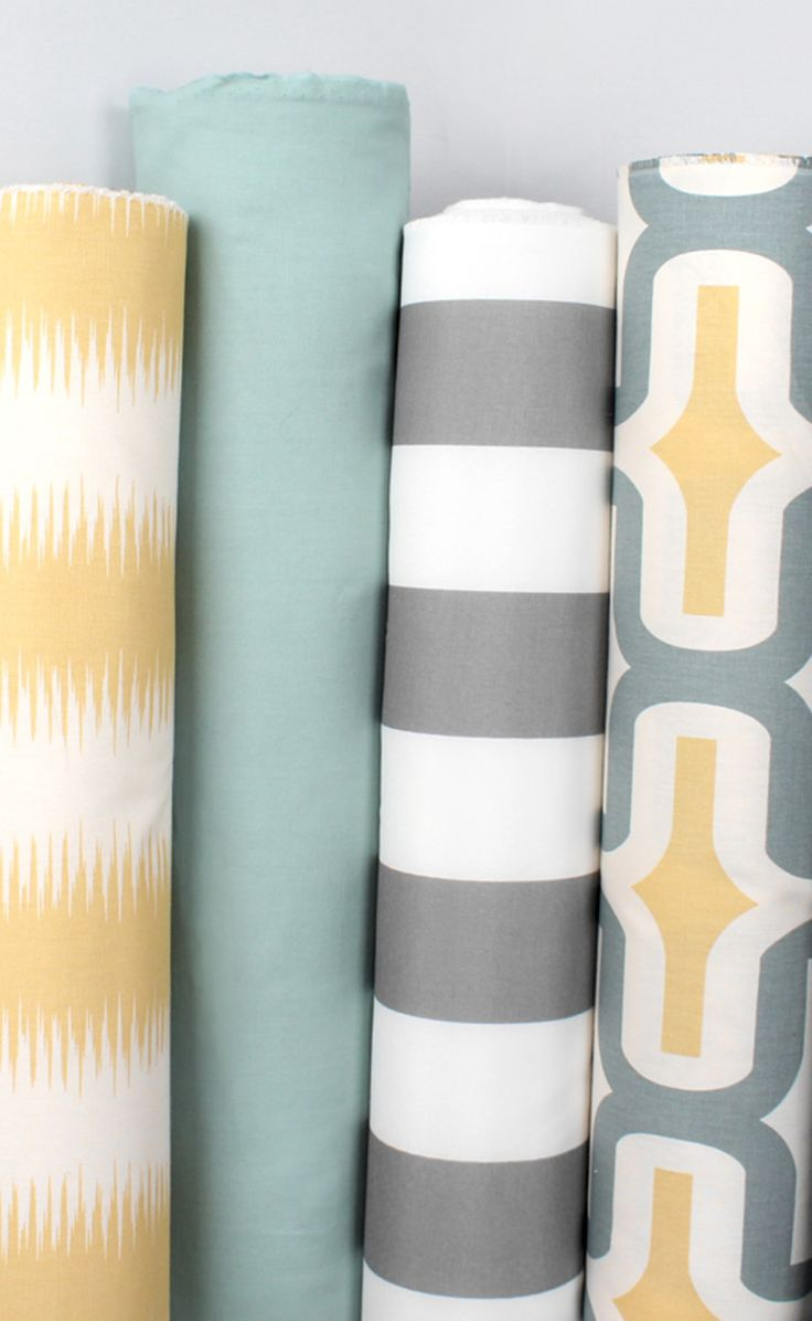 Premier Prints fabric including yellow ikat, gray stripe and more modern prints.