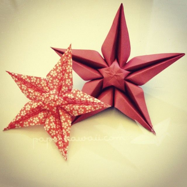 origami star flower -making the pentagon was the most difficult part. This model has a lot of potential for decor, I'm going to play around with the type of paper I use from now on with this one.